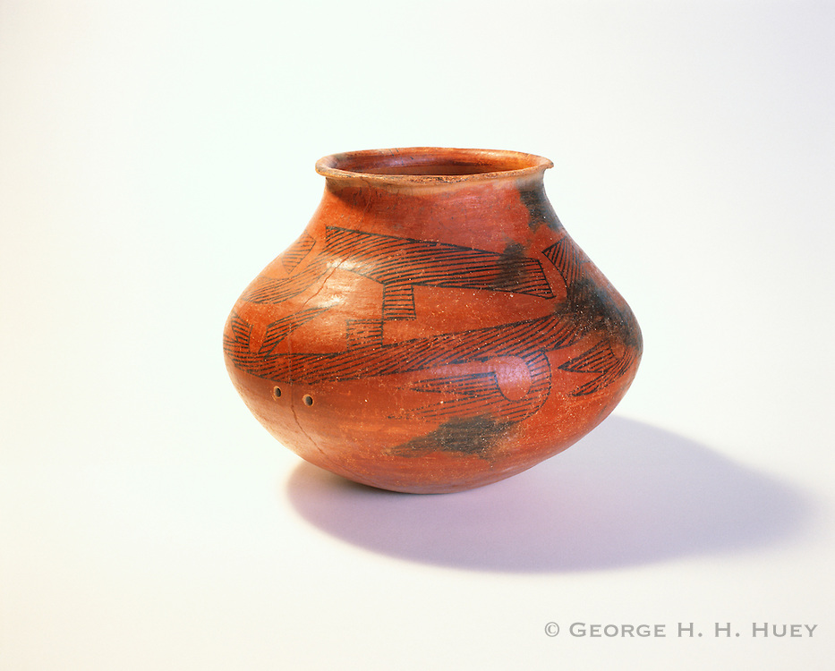 0111-1017 ~ Copyright: George H. H. Huey ~ Tusayan Black-on-red jar, with mend holes visible. Kayenta Anasazi culture. Jar dates from A.D. 1050-1150. Navajo National Monument Arizona.