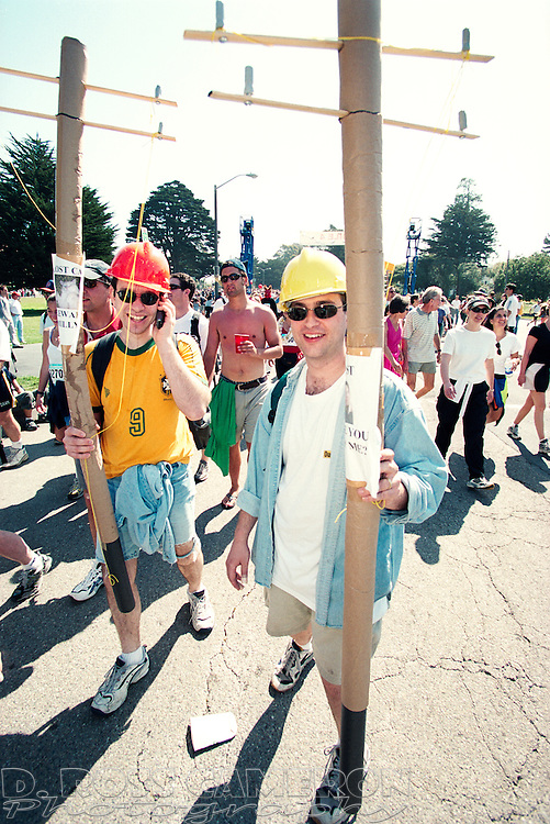 Unidentified men costumed as utility line workers carry fake telephone poles through Golden Gate Park at the 90th running of the Bay to Breakers 12K race, Sunday, May 20, 2001 in San Francisco. Many of the costumed runners made light (no pun intended) of California's power woes. (Photo by D. Ross Cameron)