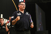 Gary Anderson celebrates beating Michael van Gerwen to reach the final during the BWIN Grand Slam of Darts at Aldersley Leisure Village, Wolverhampton, United Kingdom on 18 November 2018.