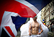A man waiving a union jack flag, attends the annual Gay Pride parade in London, Britain, 29 June 2013. BOGDAN MARAN / BPA