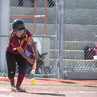 Rehoboth Lynx Jessica Lee (3) bunts the ball during the game against Tohatchi in Gallup Tuesday.