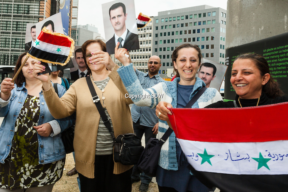BrusselsBelgium, May 20 2011: a small group of Belgian Syrians protest againts European intervenance in Syrie, and are in favour of president Bashar al-Assad. Holding his picture in front of the European committee, demonstrating.Women demonstrate separated of the men.©REPORTERS/SANDERDEWILDE
