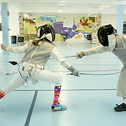 Reaghan Juelke, 11, left and Gerrit Swart, 9, fence during a Cape Fear Fencing Association youth fencing tournament at Tileston Gym in Wilmington, N.C. Saturday May 31, 2014. (Jason A. Frizzelle)