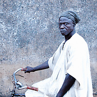Man from Tamale, Ghana Sitting On His Vintage BIcycle