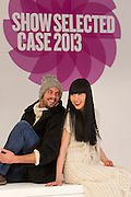 Repro Free: 20/01/2012.Pictured at the opening of Showcase 2013 are models Yomiko (wearing an Aran dress by Aran Crafts of Ireland / West End Knitwear) and Karl (wearing Black velvet trim Duffel coat by Siobhan Wear, Cable knit Polo, West End Knitwear and hat by Gonne Wilde) showcasing the best of fashion from leading Irish designers and homewear this week at Ireland's largest international trade fair. Showcase takes place at the RDS from Sunday 20th to Wednesday 23rd January. For more information visit www.showcase .com. Picture Andres Poveda