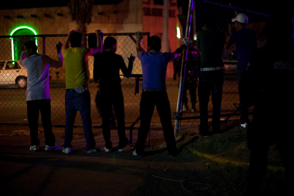 Police line up individuals involved in a fight in the parking lot of Morocos night club in Ciudad Juarez, Chihuahua Mexico on May 2, 2010.