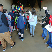 Family Resource Center Volunteer Katlynn McDonald, with MDHS of Pontotoc County, directs Baldwyn High School students to their seats as they arrive at the BancorpSouth Arena for The Family Resource Center's Healthy Teens Rally Tuesday morning in Tupelo.