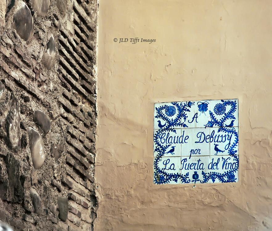 http://www.classicalconnect.com/Piano_Music/Debussy/from/6629, a piece the composer wrote about this particular door in the Alhambra.  A blue and white tile inscription commemorates this.