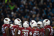 January 24, 2016: Carolina Panthers vs Arizona Cardinals. Arizona Cardinals huddle