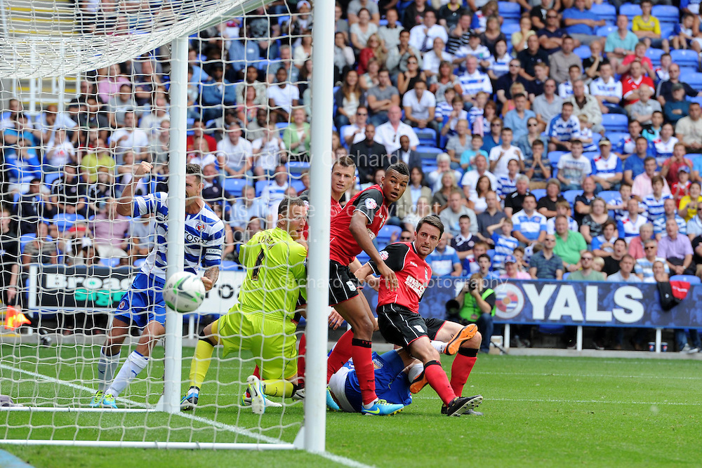 Reading's Adam Le Fondre (on ground) scores the equalising goal from close range to make it 1-1, tv replay's show it as an own goal with the final touch off Cole Skuse of Ipswich (right).   Sky Bet Championship, Reading v Ipswich Town at the Madejski Stadium in Reading,  England on Saturday 3rd August 2013. pic by Andrew Orchard,  Andrew Orchard sports photography,