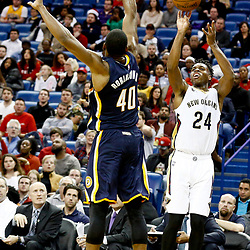 Dec 15, 2016; New Orleans, LA, USA; New Orleans Pelicans guard Buddy Hield (24) shoots over Indiana Pacers guard Glenn Robinson III (40) during the second half of a game at the Smoothie King Center. The Pelicans defeated the Pacers 102-95. Mandatory Credit: Derick E. Hingle-USA TODAY Sports