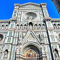 Duomo Façade Detail in Florence, Italy<br /> Although the Basilica of Saint Mary of the Flower was finished in 1436, this gorgeous façade of pink, green and white marble was not started for another 440 years and was completed in 1887.  There are so many ornate features spread across its 124 foot width that it is hard to describe them all.  The most beautiful ones include three rose windows, three tympanum mosaics over the doors and the row of 12 apostle statues.