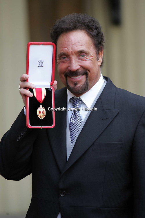 Singing legend Tom Jones displays the knighthood he received from  Queen Elizabeth II, outside  Buckingham Palace in central London, Wednesday March 29, 2006..