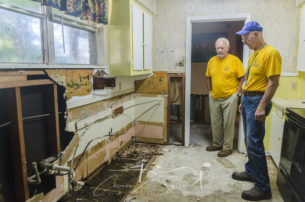 Southern Baptist Disaster Relief volunteers Gary Tracy and Roy Christy, members of Northern Hills Baptist Church in Holt, Missouri, examine homeowner Fay McDowell's kitchen, Aug. 22, 2016, in Baton Rouge, Louisiana. McDowell is one of thousands of Louisiana residents whose homes were damaged by floods last week. (Photo by Carmen K. Sisson/Cloudybright)