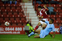 Swindon Midfielder Massimo Luongo (AUS) shoots as Plymouth Defender Curtis Nelson (ENG) tackles during the first half of the match - Photo mandatory by-line: Rogan Thomson/JMP - Tel: Mobile: 07966 386802 08/10/2013 - SPORT - FOOTBALL - County Ground, Swindon - Swindon Town v Plymouth Argyle - Johnstone Paint Trophy Round 2.
