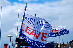 Fishing for LEAVE flags on fishing boats in Whitstable, Kent England<br /> <br /> (c) Andrew Wilson | Edinburgh Elite media