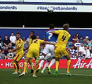 Matt Phillips (QPR midfielder) getting bundled in the box but not getting a penalty during the Sky Bet Championship match between Queens Park Rangers and Rotherham United at the Loftus Road Stadium, London, England on 22 August 2015. Photo by Matthew Redman.