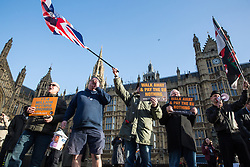 London, UK. 11th December, 2018. Pro-Brexit activists protest outside Parliament on the day on which a vote was originally to have been scheduled on completion of a House of Commons debate on the Government's draft Brexit withdrawal agreement.