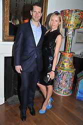 MARLON & NADYA ABELA at a dinner hosted by Marlon and Nadya Abela in aid of Kids Company at Morton's, Berkeley Square, London on 25th September 2012.