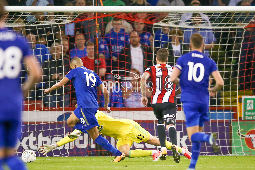 Leicester City forward Islam Slimani (19) goes around Sheffield United goalkeeper Jake Eastwood (31) and scores a goal to make the score 0-2 during the EFL Cup match between Sheffield Utd and Leicester City at Bramall Lane, Sheffield, England on 22 August 2017. Photo by Simon Davies.