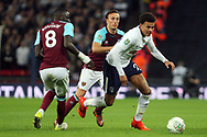 Dele Alli of Tottenham Hotspur (R) goes past Mark Noble of West Ham United &copy;. EFL Carabao Cup, 4th round match, Tottenham Hotspur v West Ham United at Wembley Stadium in London on Wednesday 25th October 2017.<br /> pic by Steffan Bowen, Andrew Orchard sports photography.