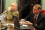 Todd Richhart of Dayton (left) and Dan Harkins of Springfield watch the Republican debate in Arizona, Wednesday, February 22, 2012.