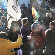 The second day of the Strike WEF march on Davos, 20th of January 2020, Switzerland. Hot juice breake put on by a local guest house on the route in solidarity with the marchers. The march started in Schiers and walked the 24 kilomers to Klosters.  The aim is to finish in Davos with a public meeting in the town on the day the WEF begins. The march is a three day protest against the World Economic Forum meeting in Davos. The activists want climate justice and think that The WEF is for the world's richest and political elite only.