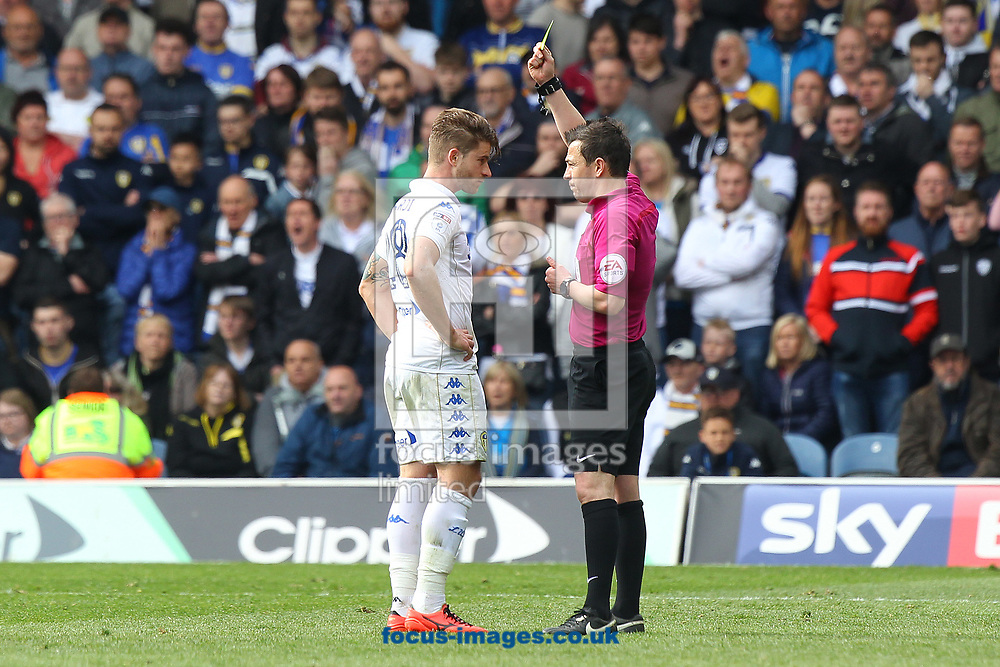 Gaetano Berardi of Leeds United gets a yellow card from Referee Tony Harrington after his clash with Graham Dorrans of Norwich during the Sky Bet Championship match at Elland Road, Leeds<br /> Picture by Paul Chesterton/Focus Images Ltd +44 7904 640267<br /> 29/04/2017