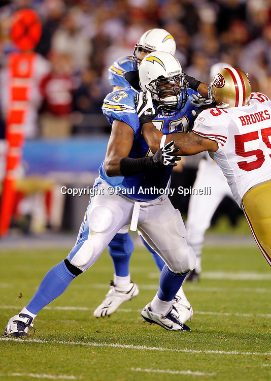 San Diego Chargers offensive tackle Marcus McNeill (73) blocks San Francisco 49ers linebacker Ahmad Brooks (55) during the NFL week 15 football game against the San Francisco 49ers on Thursday, December 16, 2010 in San Diego, California. The Chargers won the game 34-7. (©Paul Anthony Spinelli)