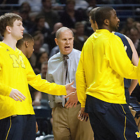 Michigan head coach John Beilein talks to his team as they come off the court for a time out during the first half of an NCAA college basketball game in University Park, Pa., Wednesday, Feb. 27, 2013.