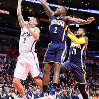 02 December 2015: Los Angeles Clippers guard Pablo Prigioni (9) goes for the layup past Indiana Pacers guard Rodney Stuckey (2) and Indiana Pacers forward Paul George (13) during the Indiana Pacers 103-91 victory over the Los Angeles Clippers, at the Staples Center, Los Angeles, California, USA.