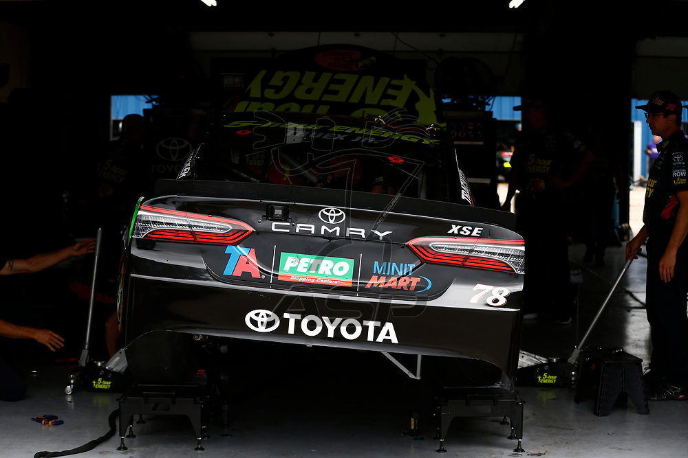 The car of Martin Truex, Jr (78) sits in the garage before practice for the Consumers Energy 400 at Michigan International Speedway in Brooklyn, Michigan.