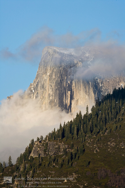 Clouds and fog gather around Half Dome  - Yosemite National Park, California