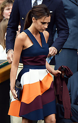 Image licensed to i-Images Picture Agency. 06/07/2014. London, United Kingdom. Victoria Beckham arriving in the Royal Box  at the Wimbledon Men's Final.  Picture by Andrew Parsons / i-Images