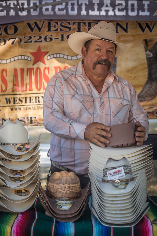 """Sales are very very good!""  -Adolfo Pena owner of Evaquero Western Wear sells hats during the Napa County Fairgrounds July Fourth weekend celebration in Calistoga"