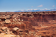 The rugged canyons of Canyonlands National Park extend in all directions as seen from The White Rim Trail near Moab, Utah.  The canyons have been cut over eons by water, wind and the elements creating a rugged landscape that are a playground for adventurers and hideaways for outlaws.