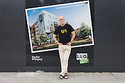 English author/writer Ian Sinclair in his native Hackney, the location for many of his dystopian views on East London. The poster is an artist's impression of new London Housing Association company L & Q who are replacing older generation homes, changing for the worse he says, the character of the borough.