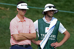 June 22, 2018 - Cromwell, Connecticut, United States - Beau Hossler (L) and his caddie wait on the 18th hole during the second round of the Travelers Championship at TPC River Highlands. (Credit Image: © Debby Wong via ZUMA Wire)