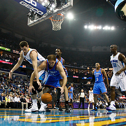 January 24,  2011; New Orleans, LA, USA; New Orleans Hornets power forward Jason Smith (14) and Oklahoma City Thunder center Nenad Krstic (12) reach for a loose ball during the first half at the New Orleans Arena. The Hornets defeated the Thunder 91-89. Mandatory Credit: Derick E. Hingle