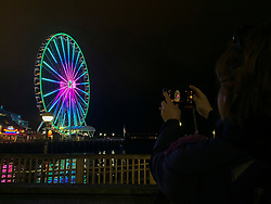 United States, Washington, Seattle Great Wheel , and woman with camera  MR