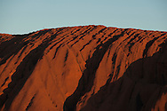 Shadows cast by ridges at the top of Ayers Rock