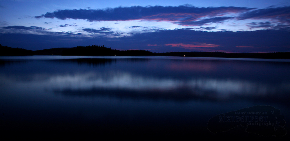 The last color of sunset fades into the blues of evening over Tupper Lake in Adirondack Park near the town of Tupper Lake, New York.  Photo by Gary Cosby Jr.