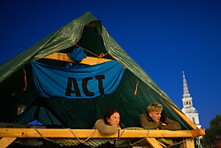 © Licensed to London News Pictures. 08/10/2019. London, UK. Two Extinction Rebellion protesters sit on a wooden structure in Trafalgar Square . Police continue to attempt to clear roads in Westminster on the second day of the protest . Photo credit: George Cracknell Wright/LNP