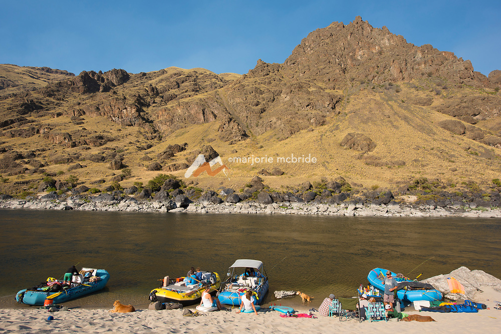 Resting in the sand at camp while rafting the Main Lower Salmon River, Hammer Creek to Hellar Bar, Idaho.
