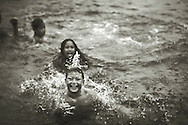 A boy and his friends swim in a seawater pool in Iva, Savai'i, Samoa.
