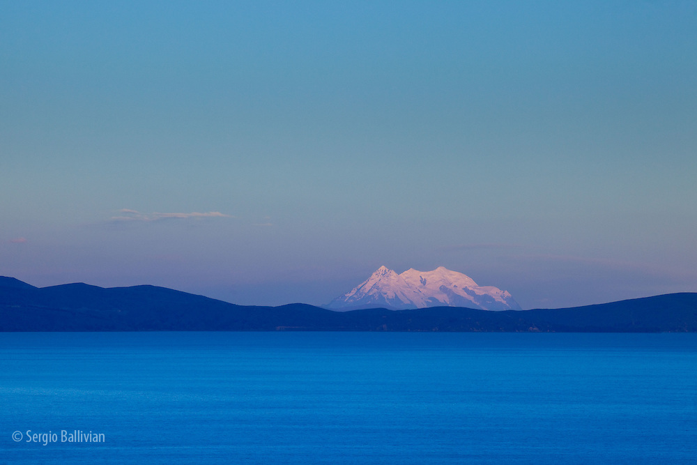 Mt. Illimani of the Cordillera Real mountain range as seen from Lake Titicaca, Bolivia