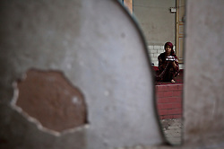 A picture made available on 31 May 2013 of a woman of the Uighur  ethnic group making traditional Uighur head dress reflected in a broken mirror in the old town of Kashgar, western edge of China's Xinjiang Uighur Autonomous Region, China 24 May 2013. Uighurs, a Muslim ethnic minority group in China, make up about 40 per cent of the 21.8 million people in Xinjiang, a vast, ethnically divided region that borders Pakistan, Afghanistan, Kazakhstan, Kyrgyzstan and Mongolia. Other ethnic minorities living in here include the Han Chinese, Kyrgyz, Mongolian and Tajiks people. In the restive region of Kashgar, western end of Xinjiang where the North and South Silk road meets, Uighurs comprise of more than 90 per cent of the 3.9 million population. Most practice a moderate form of Islam and religion is a major part of most ordinary Uighurs' lives. Tensions have been high between the Uighurs and the dominant Han Chinese as Uighurs complain of cultural and religious repression and claim that Han Chinese migrants enjoy the main benefits of development in the oil-rich but economically backward region.