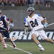 Ryan Flanagan #24 of the Charlotte Hounds controls the ball during the game at Harvard Stadium on May 17, 2014 in Boston, Massachusetts. (Photo by Elan Kawesch)