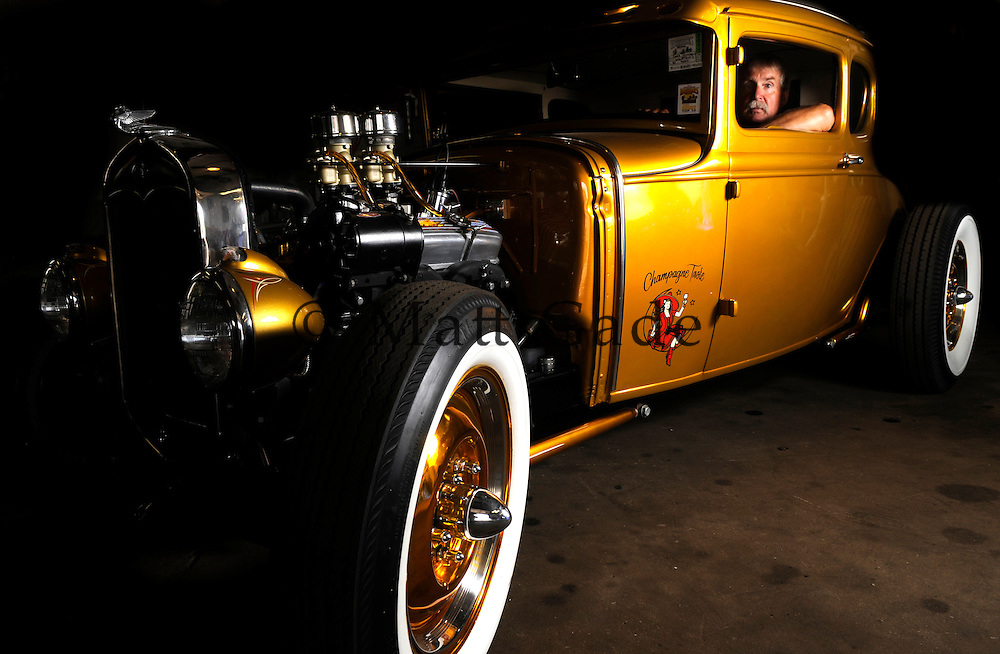 Dorr Johnson with his 1930 Ford Coupe. Johnson has been selected as one of Street Rodder Magazine's Top 100 street rods, and come November, he will compete against 99 other street rods for the magazine's Street Rodder of the Year..Date Shot 8-9-11.(Matt Gade | Grand Rapids Press)