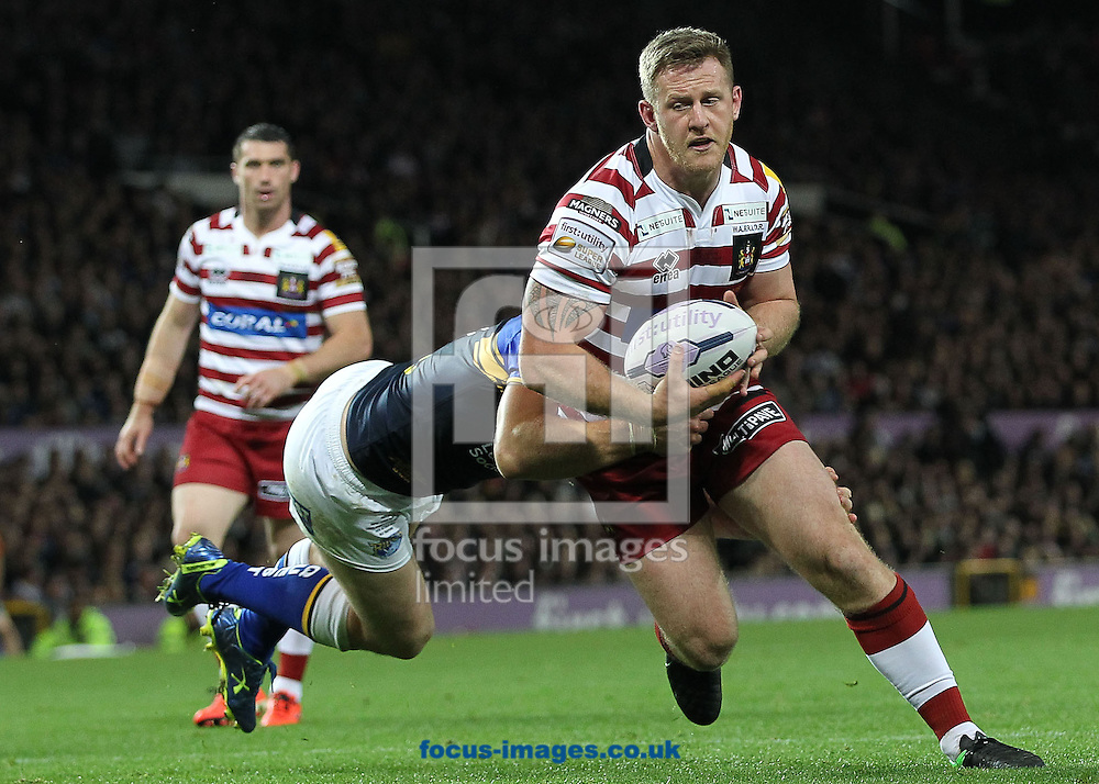 Joe Burgess of Wigan Warriors attempts to get through Carl Ablett of Leeds Rhinos during the First Utility Super League Grand Final match at Old Trafford, Manchester.<br /> Picture by Michael Sedgwick/Focus Images Ltd +44 7900 363072<br /> 10/10/2015